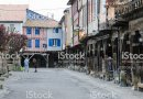 Mirepoix, France - April 8, 2014: Wooden arcaded streets of the French medieval village of Mirepoix.